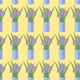 Vector seamless pattern with bouquets of iris flowers in blue vase. Stock Photography