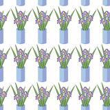 Vector seamless pattern with bouquets of iris flowers in blue vase. Stock Image
