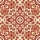 Vector seamless pattern with bright brown ornament. Tile in Eastern style. Ornamental lace tracery. Royalty Free Stock Photography
