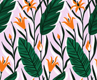 Vector seamless pattern with bright tropical flowers and palm leaf. Royalty Free Stock Photos