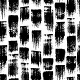 Vector seamless pattern with brush stripes and strokes. Black color on white background. Hand painted grange texture. Ink geometric elements. Fashion modern Royalty Free Stock Images