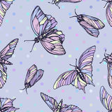 Vector seamless pattern with butterflies in soft colors. Stylish graphic texture. Repeating print on pastel blue Stock Images