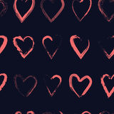 Vector seamless pattern with calligraphic brush hearts. Pink on dark blue background Royalty Free Stock Photography
