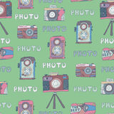 Vector seamless pattern of cameras photos doodles . Stock Image