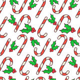 Vector seamless pattern. Candy canes and holly berry. Christmas wrapping paper design. White background Stock Images