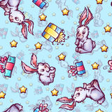 Vector seamless pattern with cartoon rabbits and Stock Images