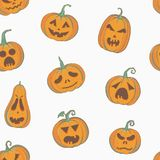 Halloween pattern with carved pumpkins. Vector seamless pattern with carved pumpkins. Halloween seamless background, decorative wrapping paper with pumpkins Royalty Free Stock Image