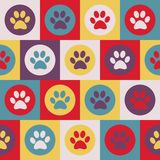 Vector seamless pattern with cat or dog footprints. Cute colorfu royalty free stock photography