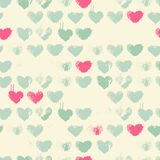 Vector seamless pattern with cat head. Vector seamless pattern with grunge hearts (Ink Stamp). Pastel color palette with pink and sea green. Romantic texture for Royalty Free Stock Photos