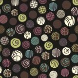 Vector seamless pattern with chocolate sweets on a black background. Decorative pattern for design Stock Images
