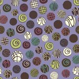 Vector seamless pattern with chocolate sweets on a purple background. Decorative pattern for design Stock Photo