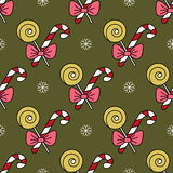 Vector seamless pattern with Christmas candy canes. For Christmas holidays and New Year 2017. Vector illustration for Merry Christmas and Happy New Year print Royalty Free Stock Photos