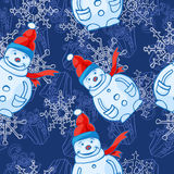 Vector seamless pattern. Christmas and winter theme. Snowmen. Royalty Free Stock Images