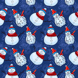Vector seamless pattern. Christmas and winter theme. Snowmen. Stock Photo