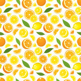 Vector seamless pattern of citrus products - lemon and orange with leaves. Royalty Free Stock Images