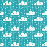 Vector seamless pattern with clouds and snowflakes. Stock Photography