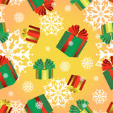 Vector seamless pattern with colorful boxes of Christmas gifts and snowflakes. New Year or Christmas background. Stock Images