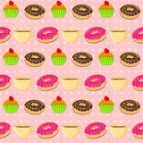 Vector seamless pattern with colorful donuts, muffins and tescup Royalty Free Stock Images