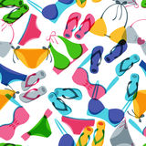 Vector seamless pattern with colorful hand drawn swimsuits and flip flops. Stock Photos