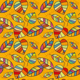 Vector seamless pattern with colorful leaves on a yellow background Stock Photography