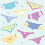 Vector seamless pattern with colourful cute panties on striped background Royalty Free Stock Images