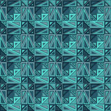 Vector seamless pattern. Consists of geometric elements.The elements have a triangular shape and different color. Stock Photos