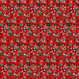 Vector seamless pattern. Consists of geometric elements on red background. The elements have a triangular shape. Royalty Free Stock Image