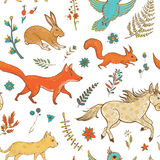 Vector seamless pattern with cute animals and plants Royalty Free Stock Image