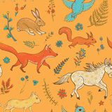 Vector seamless pattern with cute animals and plants Royalty Free Stock Images