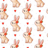 Vector seamless pattern with cute bunny on a white background. Stock Photography