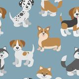 Vector seamless pattern with cute cartoon dog puppies. Royalty Free Stock Photo