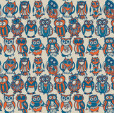 Vector seamless pattern with cute colorful owls. Stock Images