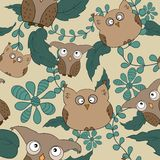 Vector seamless pattern with cute owls, leaves Stock Photography