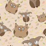 Vector seamless pattern with cute owls, leaves Stock Images