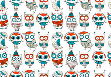 Vector seamless pattern with cute owls in warm clothes and cute cups with coffee and tea. Golden glitter effect. Stock Images