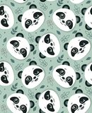 Vector seamless pattern with cute panda faces and leaves vector illustration
