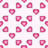 Vector seamless pattern with cute pink hearts Stock Image