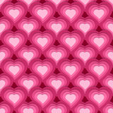 Vector seamless pattern with cute pink hearts Stock Photography