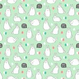 Vector seamless pattern with cute rabbits and eggs for Easter design. Stock Photo