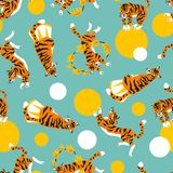 Vector seamless pattern with cute trained tigers and balls.  Royalty Free Stock Images