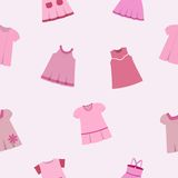Vector seamless pattern of different pink dresses for baby girls. Seamless pattern with fashionable children's dresses on gray-pink background. Collection cute Royalty Free Stock Photo