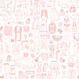 Vector seamless pattern of different women's clothes Royalty Free Stock Image