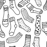 Vector seamless pattern of doodle socks for web design, prints etc. Repeating background can be copied without any seams. Invitation, postcard, banner. Vector Stock Image