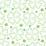 Vector seamless pattern with dotted lucky four leaf clover or shamrock in green on the white background. Holiday background. Stock Photography