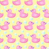 Vector seamless pattern with ducks. Duckling isolated on white background. Vector illustration. Rubber ducky for bath on Royalty Free Stock Photography