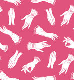 Vector seamless pattern with elegant lace gloves on the pink background. Royalty Free Stock Photography