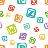 Vector seamless pattern - english alphabet in colorful squares Stock Images