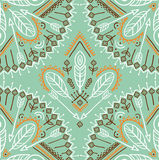 Vector seamless pattern with ethnic arrows, feathers and tribal ornaments. Stock Photos