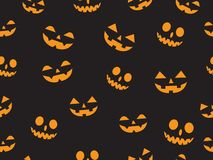 Vector seamless pattern with faces pumpkin devil in the dark background stock photo