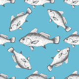 Vector seamless pattern with fishes. On blue background Royalty Free Stock Images